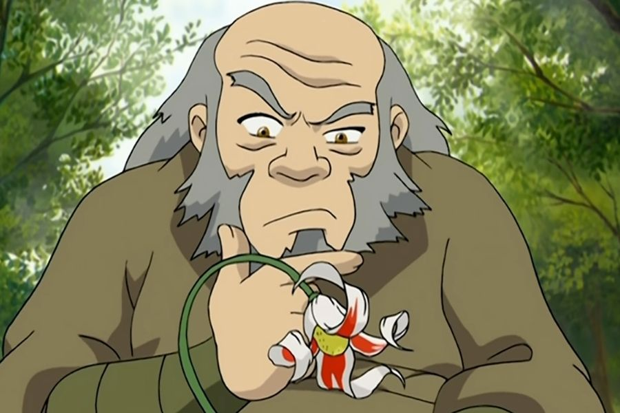 Uncle Iroh gazing at a flower