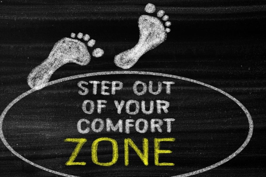 two feet are coming out of the comfort zone