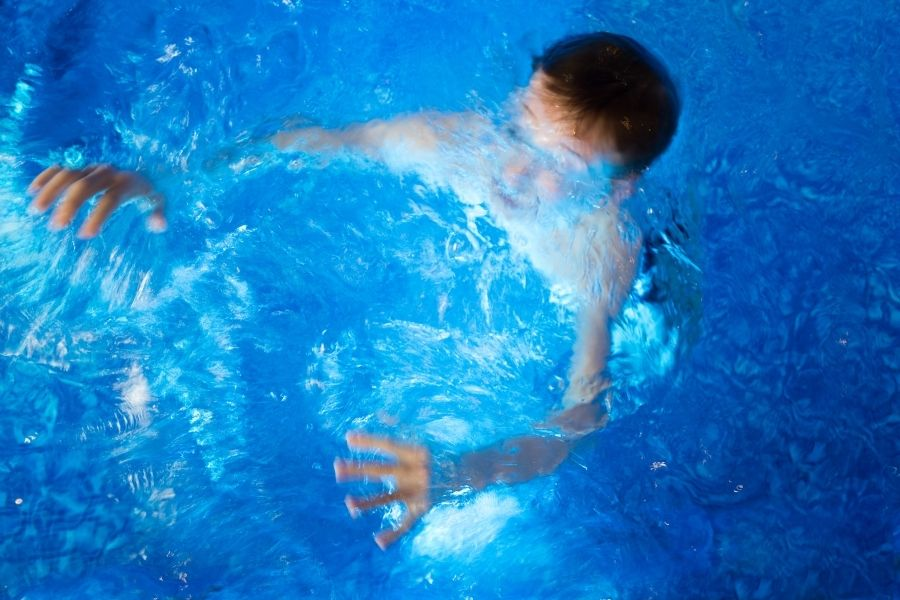 A young boy in the pool