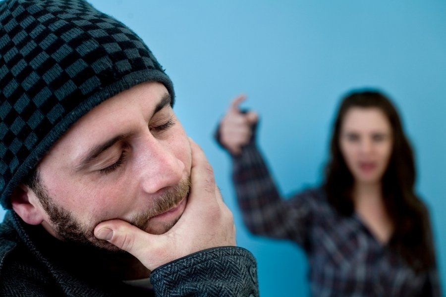 woman is yelled at stressed man